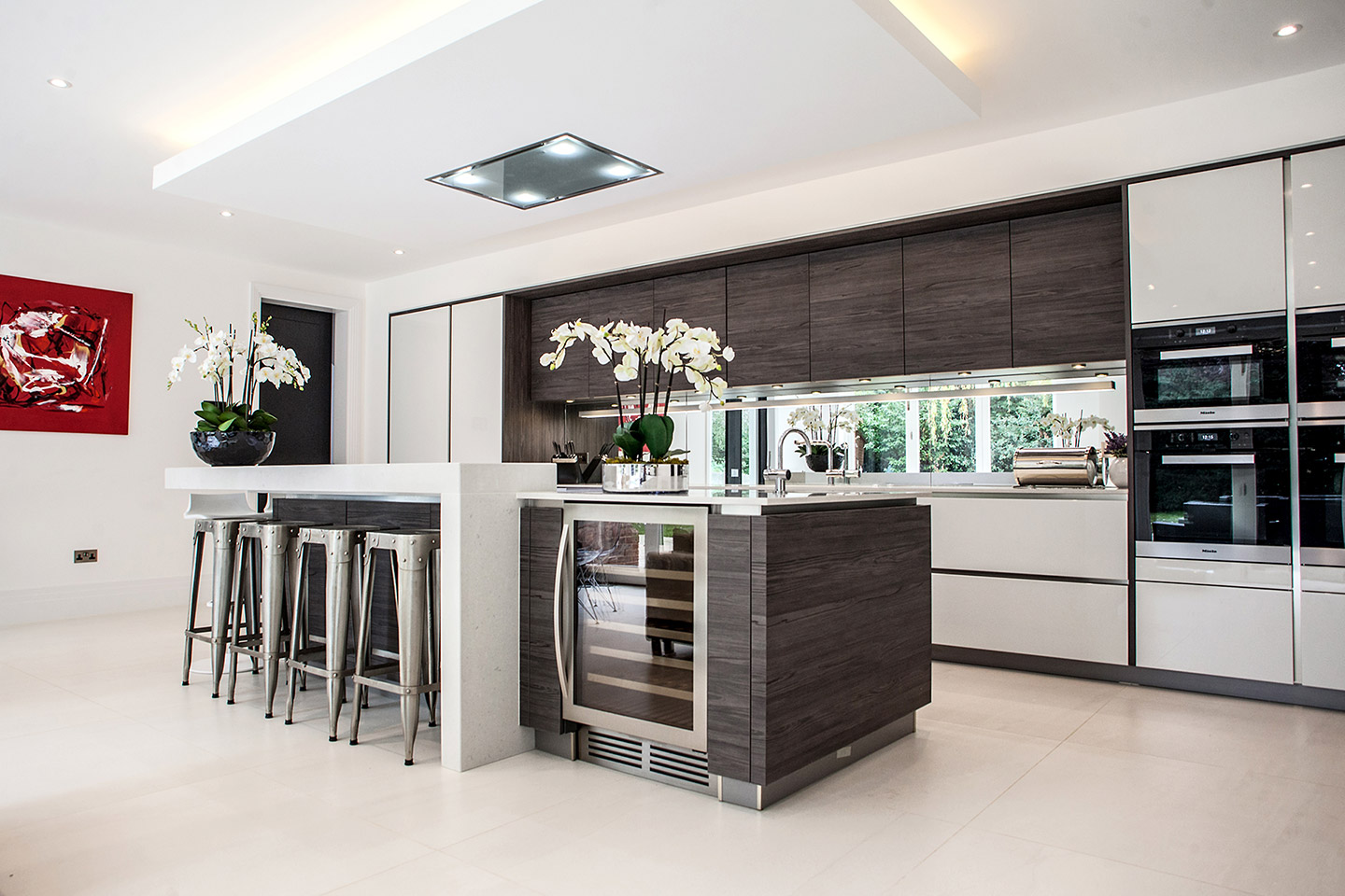 Brilliant white glossy lacquer kitchen with dark pine timber accents