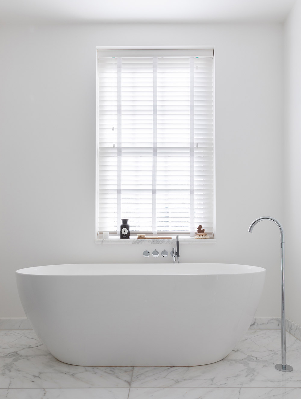 White bathroom with freestanding bath
