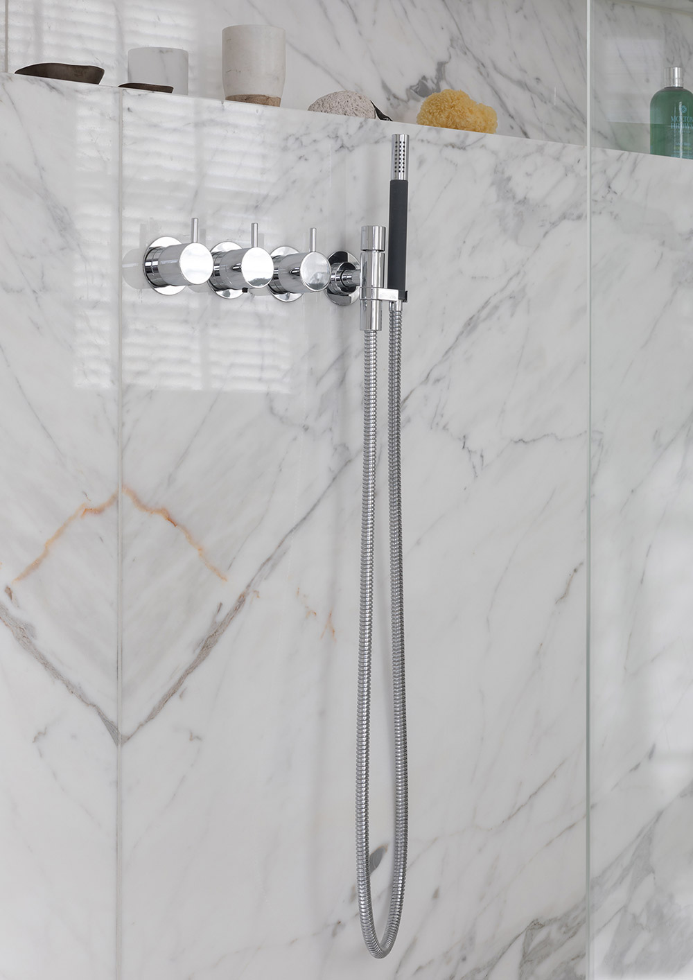 White marble carrara walk-in shower controls