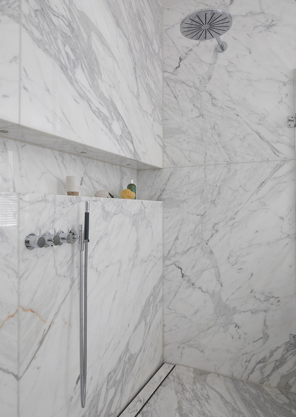 White bathroom with marble carrara tiles