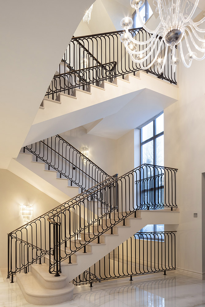 White Staircase with Black Iron Railings