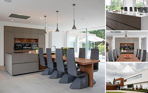 Cesar Cement Effect Kitchen - A beautiful open plan kitchen-dinner, with a cement effect finish, walnut framing, integrated dining table, and stainless steel worktops.
